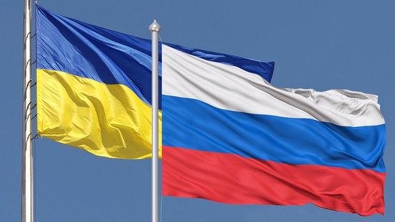 Ukrainische und russische Flagge (Bildmontage) © Fotolia Foto: fimg, Olga Kovalenk
