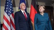US-Vizepräsident Mike Pence und Bundeskanzlerin Angela Merkel auf der Münchner Sicherheitskonferenz am 18.02.2017. © picture alliance / ZUMAPRESS.com Fotograf: State Department