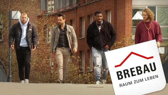 Vier Personen laufen auf einer Straße, im Vordergrund ist das Logo der Brebau © NDR /ARD Foto: Screenshot