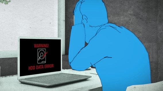 Ein Mensch sitzt vor einem schwarzen Bildschirm