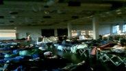 Überfüllter Schlafsaal  im Erstaufnahmelager