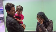 Abdullah Arian mit seiner Tochter und seiner Frau.