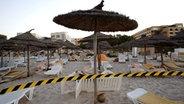 Abgesperrter Strand in Tunesien nach einem Terroranschlag © picture-alliance/dpa Fotograf: Olivier Corsan